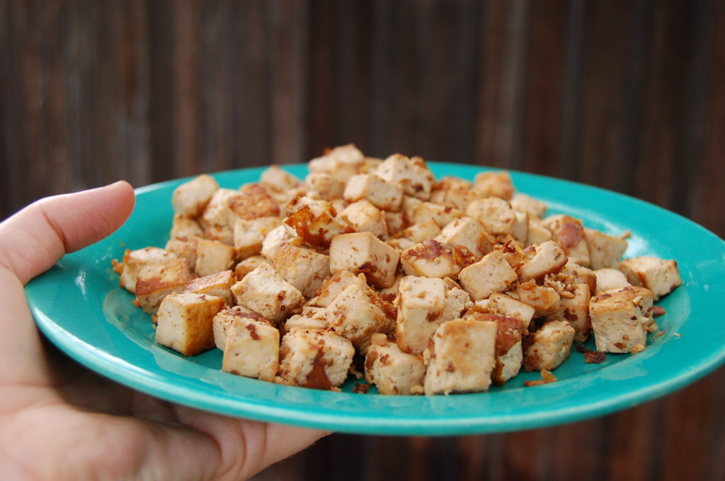 toasted_coconut_kale_salad_tofu_hand