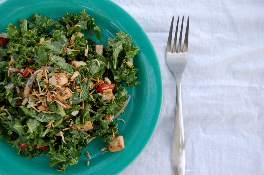 toasted_coconut_kale_salad_coconut_left_blue_plate