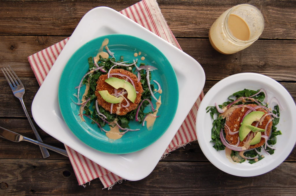 Lentil Millet Burgers over Collard Greens with Miso Tahini Dressing