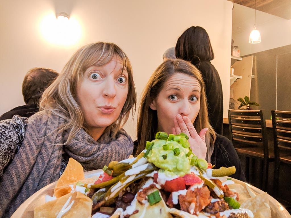 Molly & Kellie versus nachos.