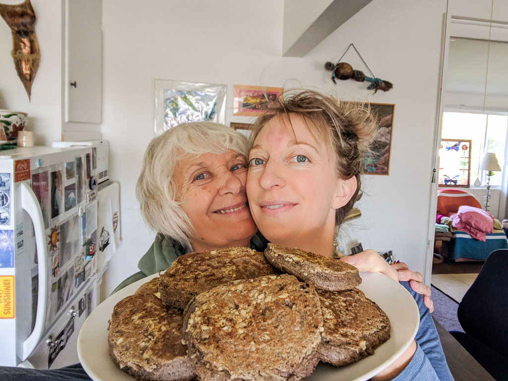 Molly's mom, Pamela, and Molly at home in Tucson with a plate of yummy whole food plant based pancakes.