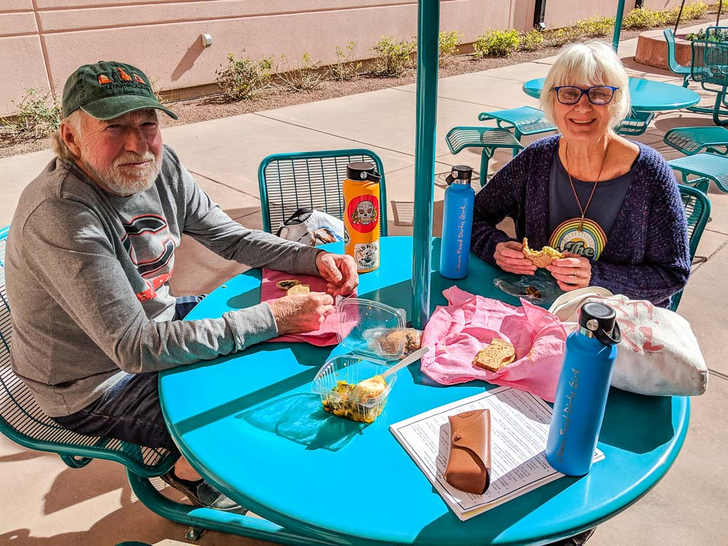 Molly's Dad and Mom having snacks outside of the VA in Tucson.
