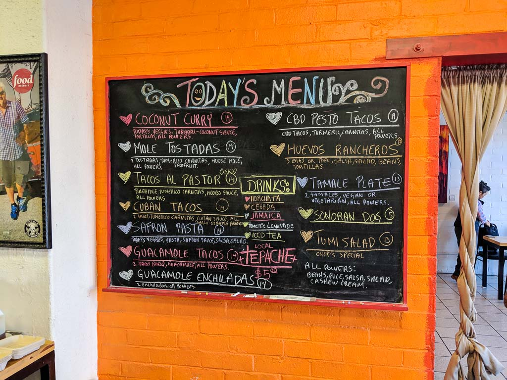 The chalkboard wall menu at Turmerico in Tucson.