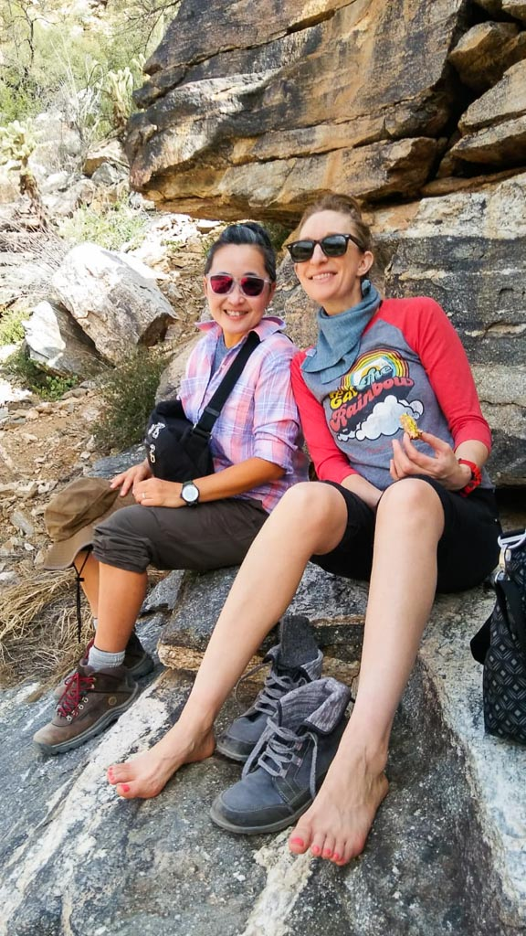Luanne and Molly on their desert hike, chillaxin on rocks with a tofu salad sandwich. Shoes off.