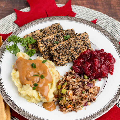 Crispy Herbed Cutlets, Mashed Potatoes, Sage Gravy, Wild Rice Stuffing and Orange Rosemary Cranberry Sauce
