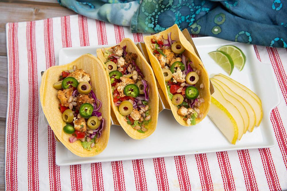 crispy vegan nugget tacos with pico de gallo and juicy pear slices